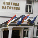 Flags in front of municipal building in Bato�ina